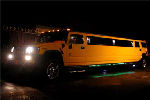 Chauffeur stretch yellow Hummer H2 limo hire in Hull, Scunthorpe, Lincoln, Grimsby, Lincolnshire, East Yorkshire