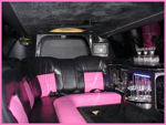 Chauffeur stretch pink limo hire interior in UK